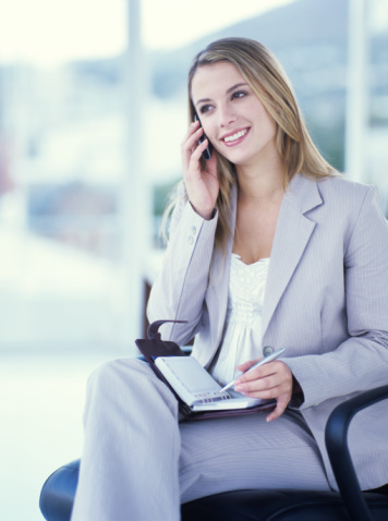 woman making appt on phone (1) 7 Tips to Build Brand Trust blog  marketing on hold featured building brand trust 7 tips